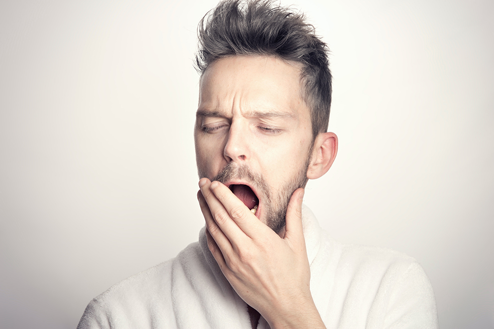 What is Insomnia - Man yawning